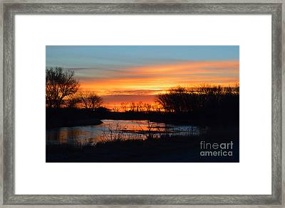 Sunrise On The River Framed Print by Renie Rutten