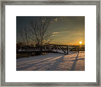 Sunrise Over A Snow Covered Bridge Framed Print by Chris Bordeleau