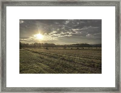 Sunrise Over Hayrolls Framed Print