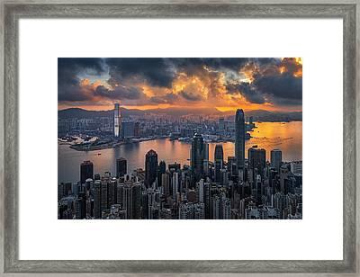 Sunrise Over Victoria Harbor Framed Print by Ratnakorn Piyasirisorost