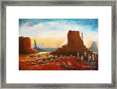 Sunrise Stampede Framed Print