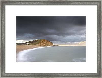 Sunrise Storms At West Bay Framed Print by Chris Frost