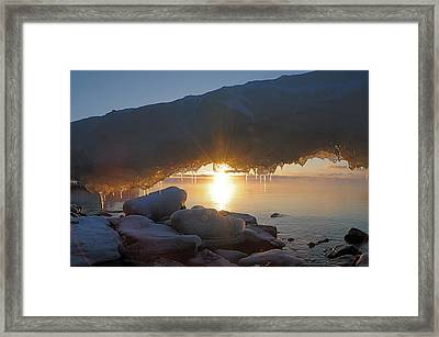 Sunrise Through The Arch Framed Print by Sandra Updyke