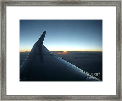Sunset Above The Clouds Framed Print