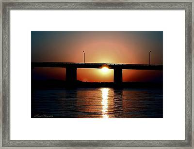 Sunset And Bridge Framed Print by Debra Forand