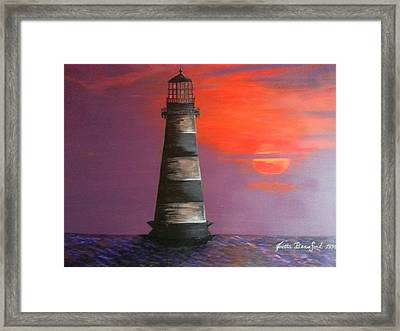 Sunset And Lighthouse Framed Print