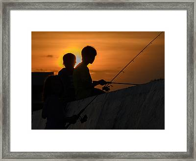 Sunset Anglers Framed Print