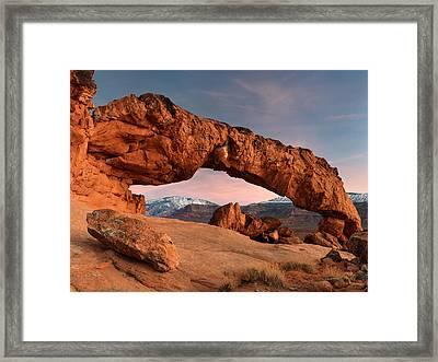 Sunset Arch Framed Print by Leland D Howard