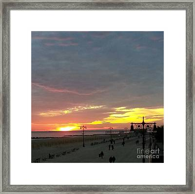 Sunset At Coney Island Framed Print by John Telfer