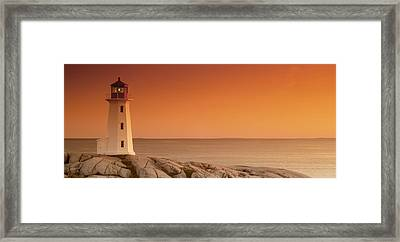 Sunset At Peggy's Cove Lighthouse Framed Print