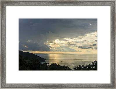 sunset at Quepos Framed Print by Russell Christie