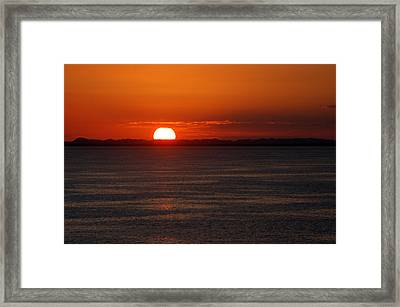 Sunset At Sea Framed Print by Allen Carroll