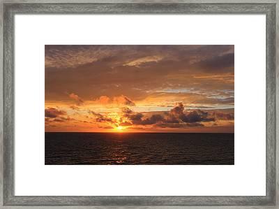 Sunset At Sea Framed Print by John Roberts