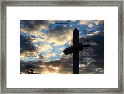 Sunset At The Cross Framed Print by Cliff Ball