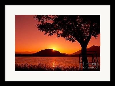 Sun Setting Behind A Mountain Framed Prints