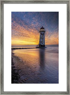 Sunset At The Lighthouse Framed Print by Ian Mitchell