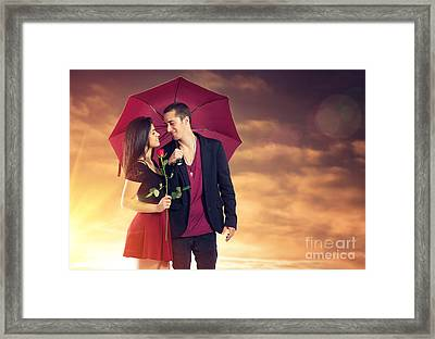 Sunset Couple Framed Print by Carlos Caetano