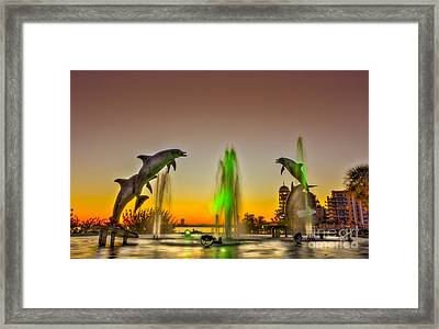 Sunset Dolphins Framed Print by Marvin Spates