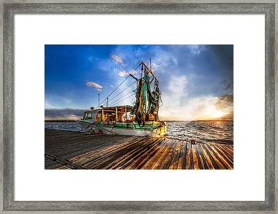 Sunset Fishing Framed Print by Debra and Dave Vanderlaan