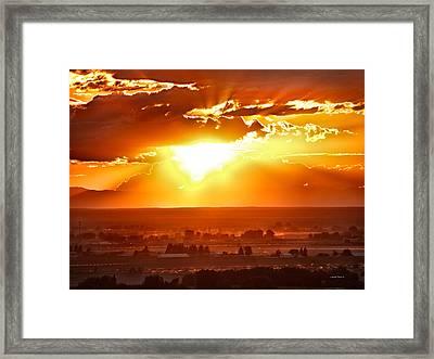 Sunset Glow Framed Print by Leland D Howard