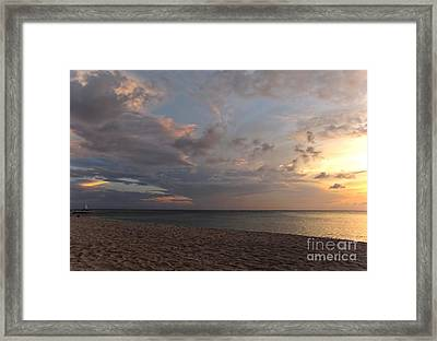 Sunset Grand Cayman Framed Print by Peggy Hughes