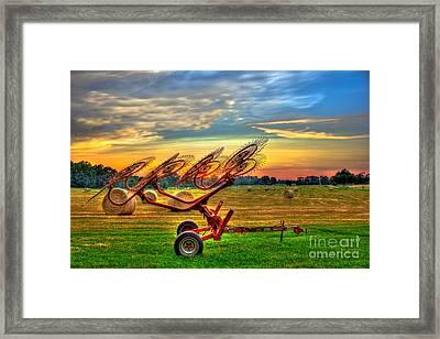 Sunset Hayrake Resting Framed Print by Reid Callaway