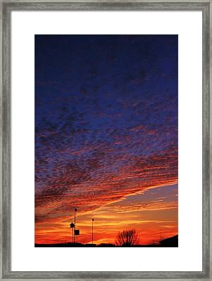 Sunset In The Clouds Framed Print by David Pauley