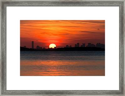 Sunset Landing Framed Print by Lee Costa