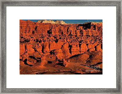 Sunset Light Turns The Hoodoos Blood Red In Goblin Valley State Park Utah Framed Print by Dave Welling