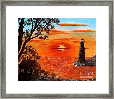 Sunset Lighthouse Framed Print by Barbara Griffin