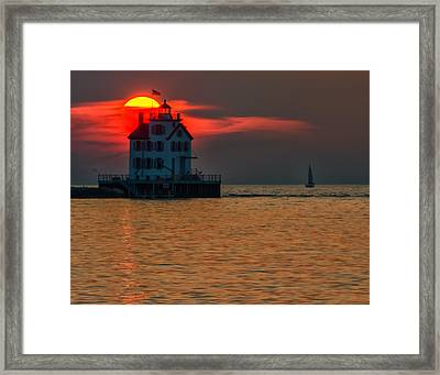Sunset On Lighthouse Framed Print