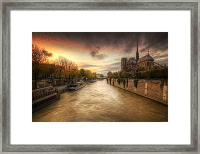 Sunset On Notre Dame Framed Print by Ryan Wyckoff