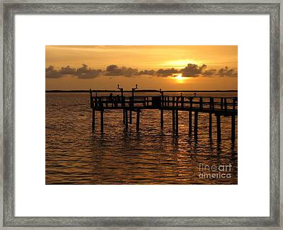 Framed Print featuring the photograph Sunset On The Dock by Peggy Hughes