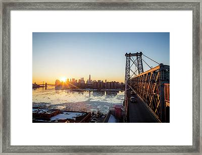 Sunset Over A City While On A Bridge Framed Print