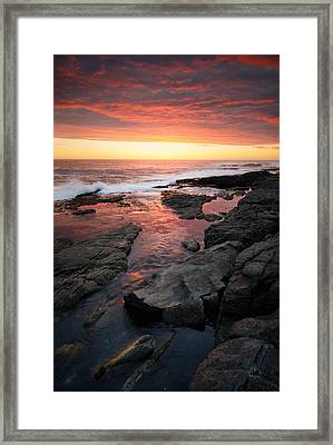 Sunset Over Rocky Coastline Framed Print