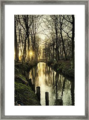 Sunset Over Stream Framed Print