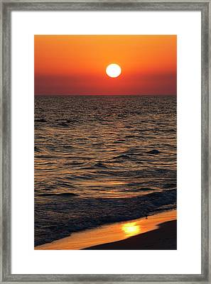 Sunset Over The Ocean And A Beach Framed Print by Jim Edds