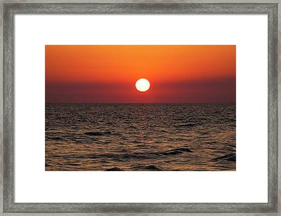 Sunset Over The Ocean Framed Print by Jim Edds