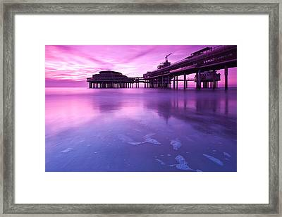 Sunset Over The Pier Framed Print by Mihai Andritoiu