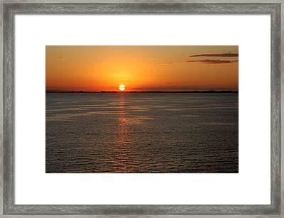 Sunset Over Water Framed Print
