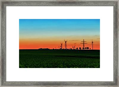 Sunset Over Wind Turbines Framed Print by Babak Tafreshi