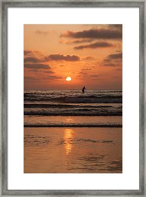 Sunset Paddle Framed Print by Sonny Marcyan