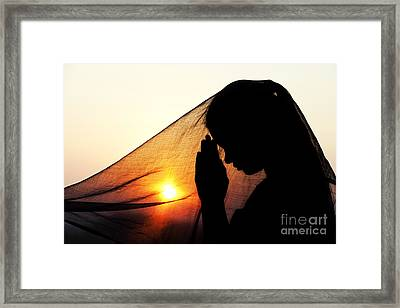 Sunset Prayers Framed Print by Tim Gainey