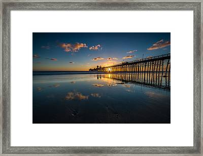 Sunset Reflections Framed Print by Larry Marshall