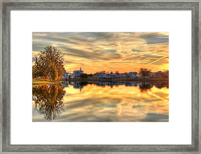 Sunset Reflections Framed Print by Leslie Kirk