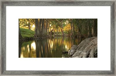 Sunset River Reflections Framed Print by Paul Huchton