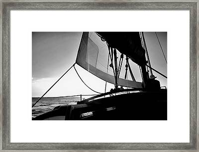 Framed Print featuring the photograph Sunset Sail In Black And White by Pamela Blizzard