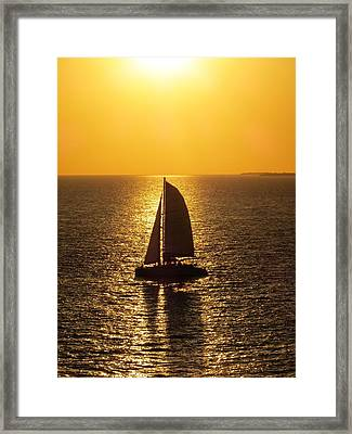 Framed Print featuring the photograph Sunset Sail by Jennifer Wheatley Wolf