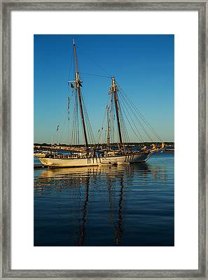 Sunset Schooner Framed Print by Karol Livote