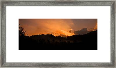 Sunset Silhouette Framed Print by Kim Lagerhem